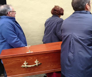Bearing the coffin